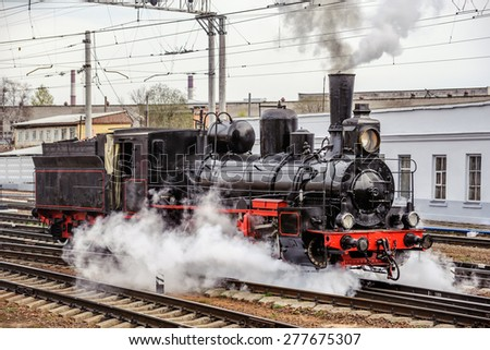 Old russian steam locomotive series Ov, builded in 1904, at railway station. - stock photo