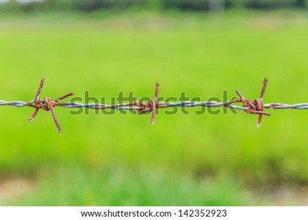 old rusted bare wire - stock photo