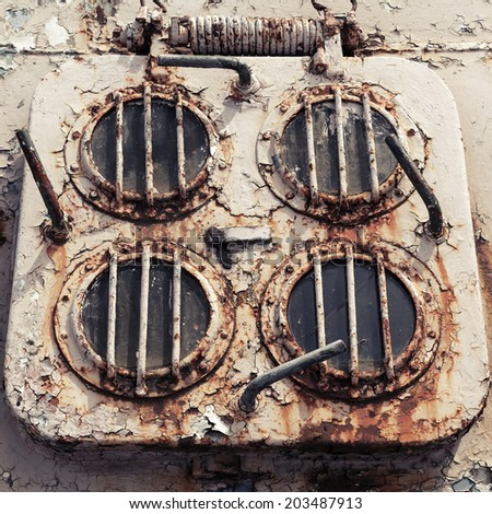 Old rusted emergency exit hatch on the deck of abandoned ship - stock photo