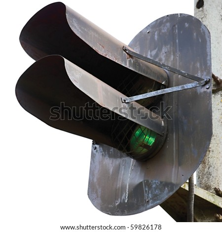 Old rusted grunge railroad green light signal, isolated macro closeup - stock photo