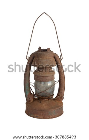 Old rusted kerosene lamp isolated on white background - stock photo