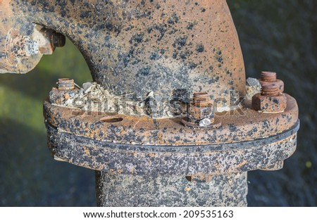 Old rusted knot on blue industrial pipeline  . - stock photo