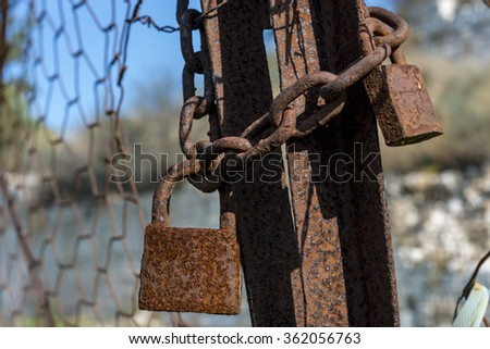 Old rusted lock - stock photo