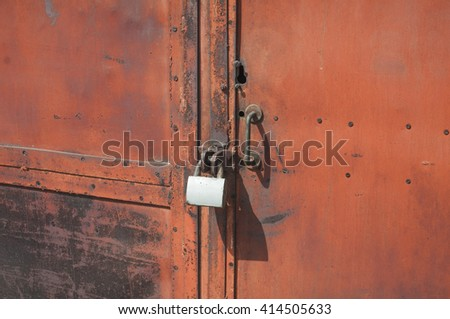 old rusted lock on a brown gate  - stock photo