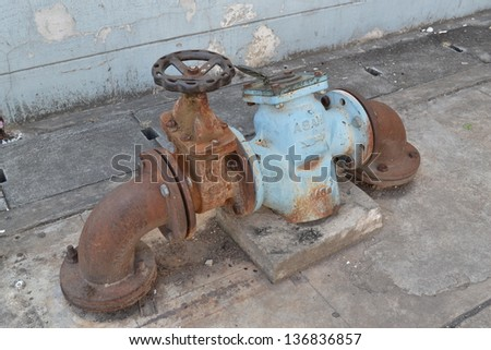 Old rusted water valve. - stock photo