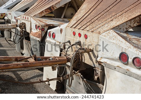 Old rustic construction truck trailers - stock photo
