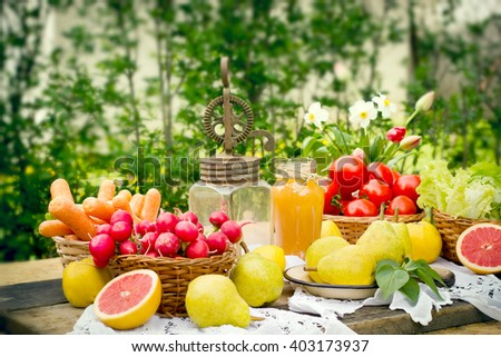 Old rustic hand blender and fruits and vegetables on table - stock photo