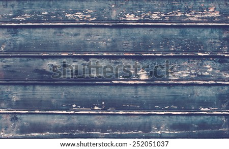 Old rustic painted cracky dark wooden texture or background - stock photo