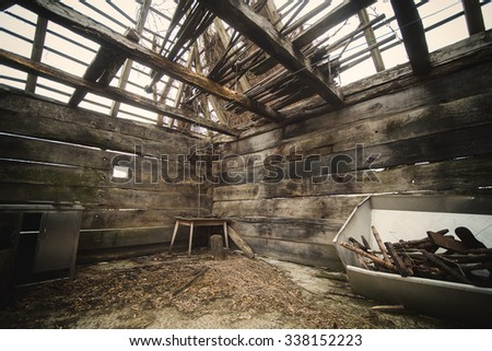 Old rustic wooden room. Abandoned. Corner. - stock photo