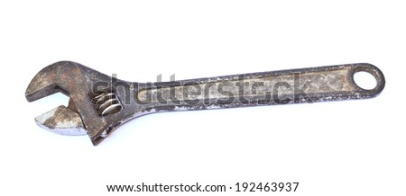 old rusty adjustable spanner on a white background is isolated - stock photo
