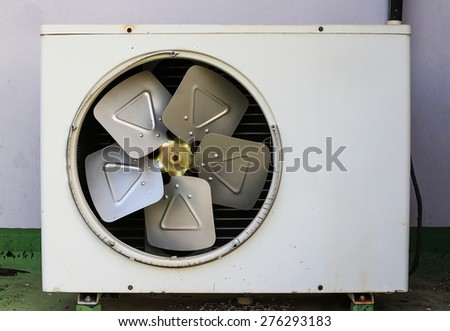 Old rusty air conditioner. wall background - stock photo