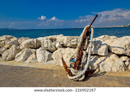 Old rusty anchor by the sea in Dalmatia, Croatia - stock photo