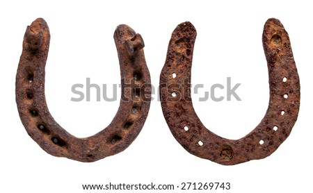 Old rusty and worn horseshoes isolated on white with natural shadows - stock photo