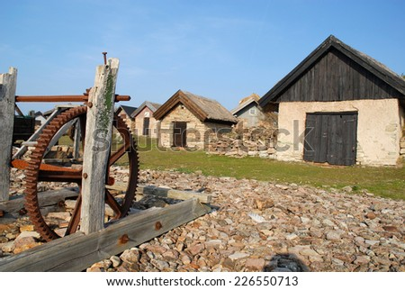 old rusty boat winch on the beach  - stock photo