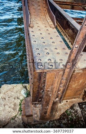 Old rusty bridge with rivets  - stock photo