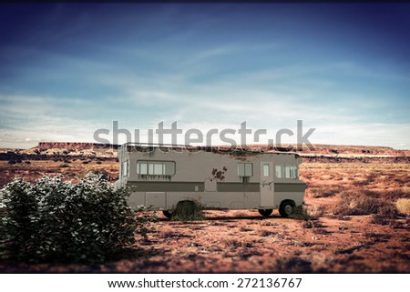 old rusty camper in New Mexico desert - stock photo