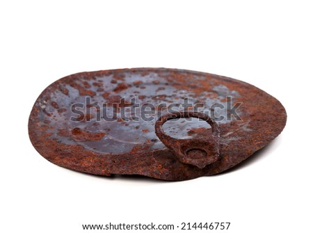 Old rusty cap of tin can isolated on white background. Selective focus. - stock photo