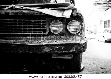 Old rusty car headlight black and white color - stock photo