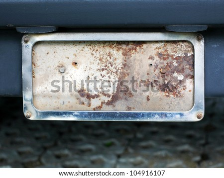 old rusty car plate - stock photo