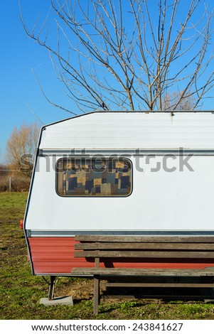 Old, rusty caravan, blue sky. - stock photo