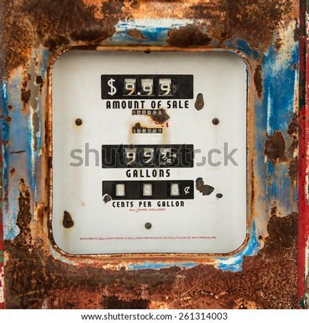 Old rusty counter on gasoline retro pump  - stock photo