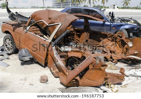 Old rusty deserted cars - stock photo