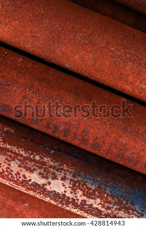 Old, rusty, dirty pipes are piled horizontally. Group of old rusty pipes Backgroun. Rust steel tube - stock photo