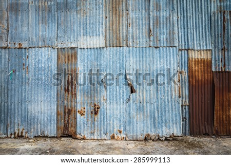 Old rusty galvanized iron plate texture background - stock photo