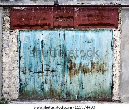 Old rusty garage door - stock photo