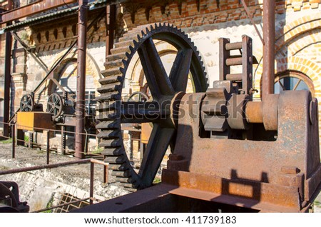 Old rusty gears, machinery parts. - stock photo