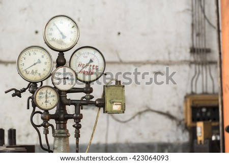 Old rusty industrial oil press gauges - stock photo