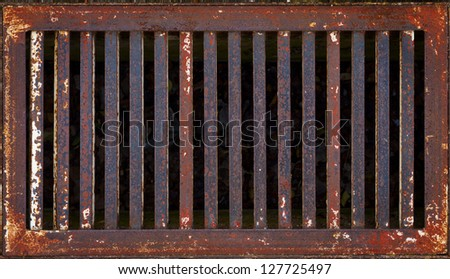 Old rusty iron drain grid. Closeup for Background - stock photo