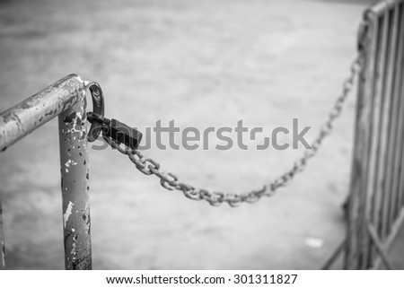old rusty key lock locked with a chain - stock photo