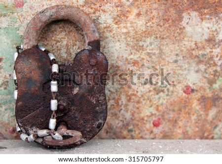 Old rusty lock with key - stock photo