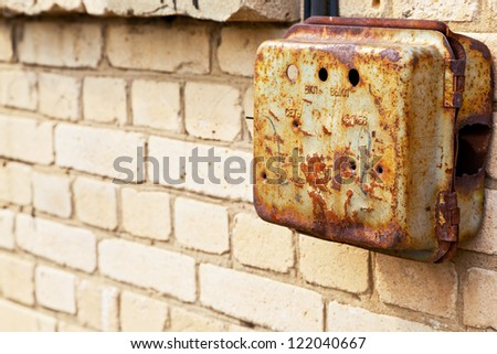 Old rusty mail box on the wall - stock photo
