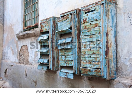 Old rusty mail boxes on the wall - stock photo