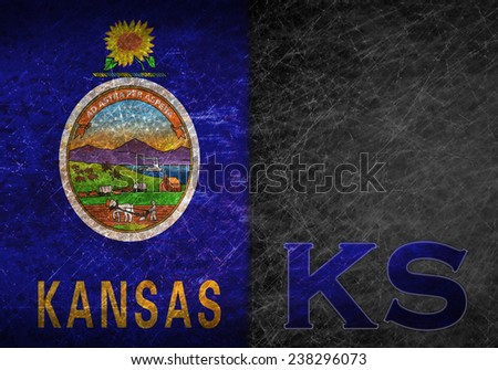 Old rusty metal sign with a flag and US state abbreviation - Kansas - stock photo