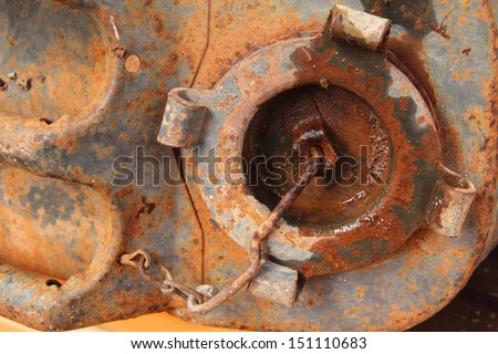 Old rusty metallic cap of jerry can - stock photo