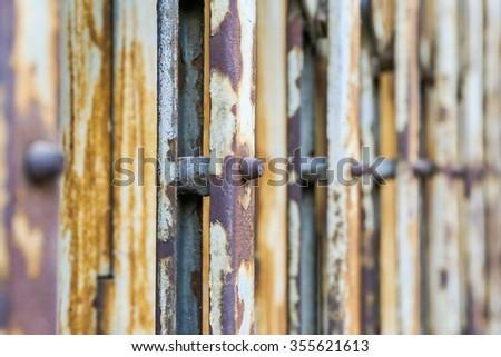 Old rusty metallic or steel or iron door. - stock photo