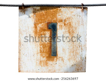Old rusty number one sign hanging on a wire - stock photo