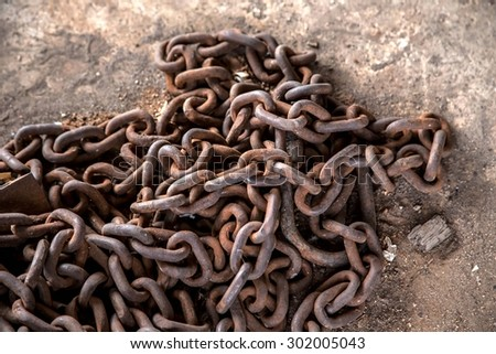 Old rusty pile of chain - stock photo