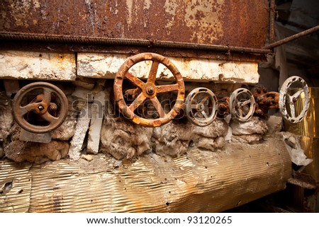 Old rusty pipes and valves - stock photo