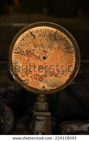 Old, rusty pressure gauge - stock photo