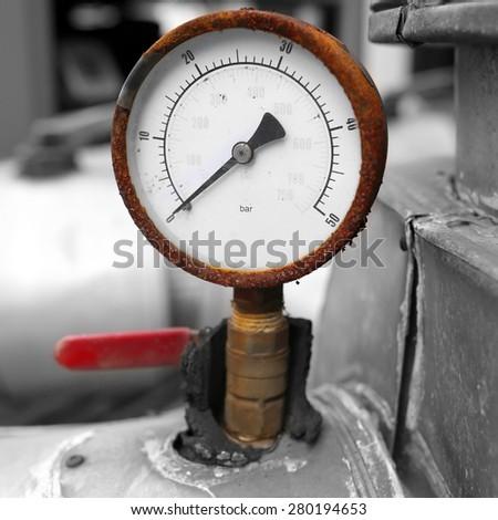 Old rusty pressure guage - stock photo