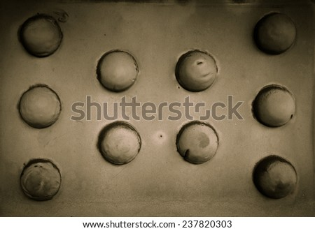 Old rusty rivets on large corroding steel plates of a train and auto Bridge. Shallow depth of field  - stock photo