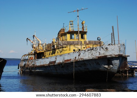 old rusty ship in the port, summer - stock photo