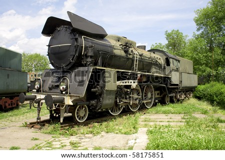 old rusty steam engine - stock photo