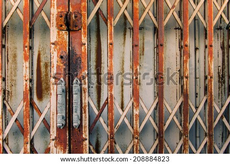 Old rusty steel door - stock photo
