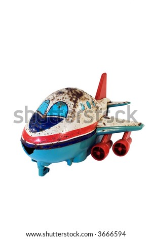 Old, rusty tin toy representing a Jumbo Jet. - stock photo