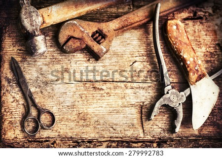 Old rusty tools, scissors, hammer on old wooden table background, fathers day background. - stock photo
